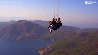 Cellist hits high notes with amazing paragliding performance in the sky