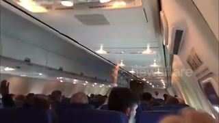 Flight attendant makes passengers sing 'happy birthday' during turbulence - Video