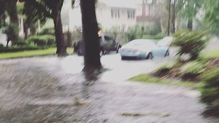 Motorists Drive Through Flooded Streets in Savannah, Georgia