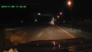 Driver amazed when meteor lights up night sky - Video
