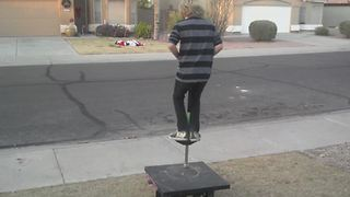 Young Boy Tries To Do A Trick On A Pogo Stick But Fails - Video