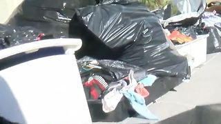 Massive trash pile sits in driveway for weeks, upsetting neighbors - Video