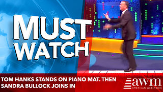 "Tom Hanks Stands On Piano Mat. Then Sandra Bullock Joins And They Play ""Chopsticks"" With Their Feet - Video"