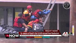 Co-owners of Coach's rescued from flooded building - Video