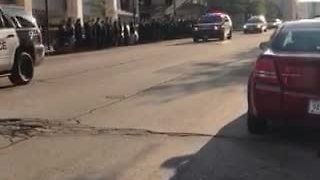Procession carrying fallen Officer Michael Michalski passes through downtown - Video