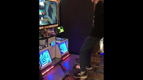 Is this the greatest arcade game dancer in the world?