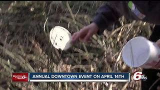 Dozens of people clean up trash along the White River - Video