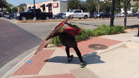 Sign Spinner Shows Incredible Skills And Takes Advertising To The Next Level