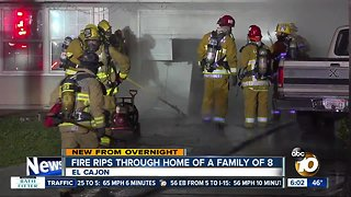 Family of 8 flees from home after garage fire
