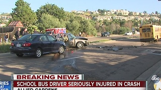 Driver seriously hurt after collision with school bus - Video