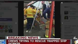 Crews trying to rescue trapped ship worker - Video