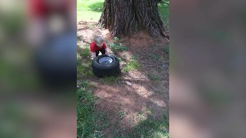 Tot Boy Helps His Father To Change A Broke Tire
