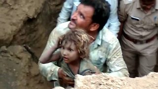 Soul-stirring moment 4-year-old is pulled out of 14 feet borewell after five hours - Video