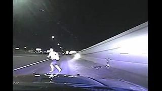 Troopers save woman trying to run into oncoming traffic - Video
