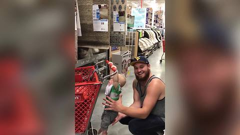 Guy In Supermarket Has A Great Fun With His Baby