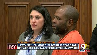Two men charged in double stabbing - Video