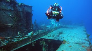 Divers explore the ghostly wreck of Russian destroyer gunship #356