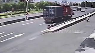 Terrifying moment boy almost gets run over by lorry