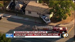 Child hurt when truck slams into home