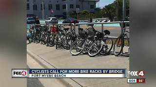 Cyclists call for more bike racks by bridge - Video