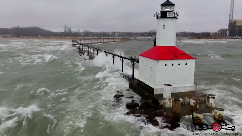 Drone footage shows monster waves crashing into Lake Michigan lighthouse