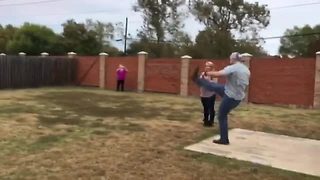 Gender Reveal Football Kicked Straight Into Neighbor's Yard  - Video