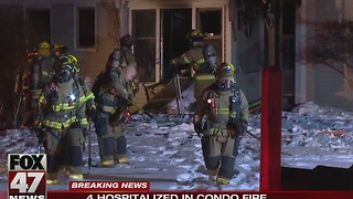Four hospitalized after condo fire in Delta Township - Video