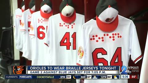 Orioles make history with Braille jerseys