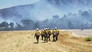 Kern County fire fighters working 100 acre fire in Bodfish - Video
