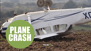Pilot has miracle escape after crashing his plane upside down into a field - Video