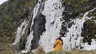Incredible video shows supernatural beauty of frozen waterfall - Video