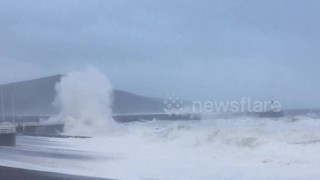 Roads closed as Storm Brian waves batter Aberystwyth, UK - Video