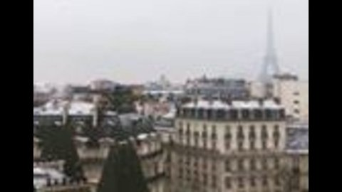 Snow Falls Over Paris as Cold Front Moves Over France