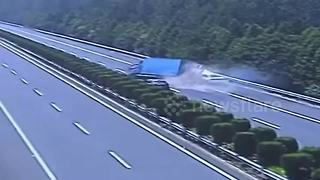 Lorry flips over on motorway after being rear-ended by speeding car - Video