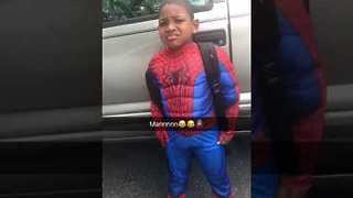 Little Boy Cleverly Changes Into Spiderman Costume at School - Video