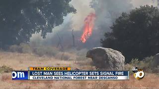 Lost man sees helicopter, sets signal fire - Video