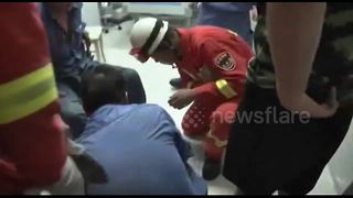 Chinese man gets electric drill stuck in his foot - Video