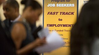 Jobless claims barely drop