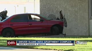 Car drives into Las Vegas apartment complex - Video