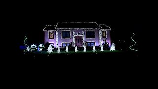 Christmas light display set to epic dance mix
