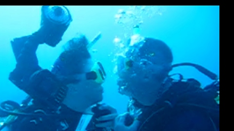 Scuba diver surprises wife with underwater wedding