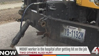 Three MoDOT workers hit on side of I-35 - Video