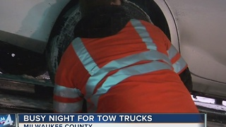 Tow truck drivers stay busy during snow storm - Video