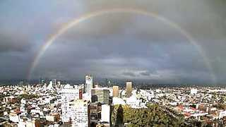 Rainbow Emerges Over Mexico City - Video