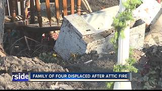 Boise family of four displaced after attic fire