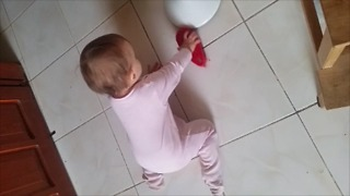 Baby helps mommy with household chores  - Video
