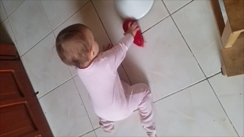 Baby helps mommy with household chores