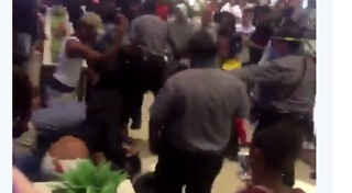 Police Intervene in Fort Worth Mall Brawl - Video