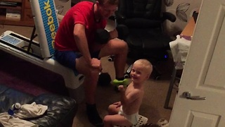 Helpful baby gives dad weightlifting tips! - Video