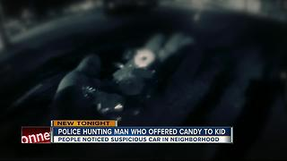 Police search for man who offered candy to child - Video